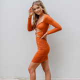 -Rust Color -Long Sleeve -Two Cutouts Down Front -Ruched In Front & Back -Mini Dress -Dress  Materials: 95% Polyester 5% Spandex  TWIST DRESS RSTSAT