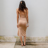 -Tan Color -Wooden Hoops -Halter -Two Cutouts Down Front -Ruched on Side with Drawstring -Side Slit at Bottom -Dress  Materials: 95% Polyester   5% Spandex  MIDI DRESS TAN
