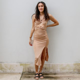 -Tan Color -Wooden Hoops -Halter -Two Cutouts Down Front -Ruched on Side with Drawstring -Side Slit at Bottom -Dress  Materials: 95% Polyester | 5% Spandex  MIDI DRESS TAN