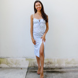 -Baby Blue Color -Pink and Green Floral Pattern -Scoop Neckline -Ties in Front -Slit at Leg -Midi Length -Dress  Materials: 83% Polyester | 17% Spandex   MIDI DRESS BLUF