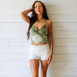 -Green Tie-Dye Color -Metal Ring in Middle -Ribbed -V-Neck -Fabric Stretches -One Size Fits All -Halter Top -Crop Top  Materials: 65% Polyester | 30% Cotton | 5% Spandex  CT5981 TANK GRN ONE SIZE