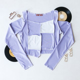 -White and Lavender Colors -Patchwork Pattern on Front -Open Shoulders -Long Sleeves -Fabric Stretches -Asymmetrical Hem -Crop Top  Materials: 95% Polyester | 5% Elastane  EA000450 TOP PRP