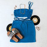 -Royal Blue Color -Adjustable Straps on One Side -Drawstring Straps -Straps Can Be Tied Around Waist -Fabric Stretches -Crop Top -Set (Top)  Materials: 95% Polyester | 5% Spandex  A47476 CROP BLU