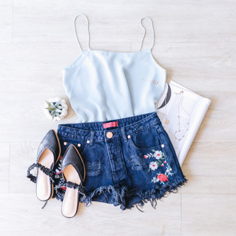 - Black Denim - Low Rise - Frayed - Floral Detail - Fabric Does Not Stretch  - Unlined  Material Contents: 100% Cotton   Model is Wearing a Size Small   S8171B SHORT