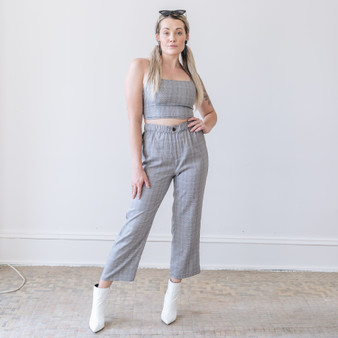 - Comes in Four Colors - Plaid Print  - Pants - Elastic Waist Band  - Button and Zipper Closure - Fabric Does Not Stretch - Unlined  Model is Wearing a Small  Material Contents: 100% Polyester  CP0681 PANT