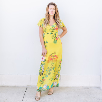 -Bright Yellow -Colorful Floral Print -Cape Sleeves -Keyhole Detail in Back -Side Slits -Lined -Material Does Not Stretch   Model is Wearing Size Small   Material: 100% Polyester    D9856 MAXI YELF