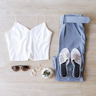 -White -Spaghetti Straps -Crop Top -V-Neck -Fitted -Unlined -Runs Large -Comes in 3 Colors  Model is Wearing Size Small  Material: 95% Polyester 5% Spandex T11481 TANK WHT