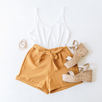 -Camel -Bow -Cuffed -Shorts -Comes in 3 Colors  Model is Wearing Size Medium  Material: 95% Polyester 5% Spandex  P11332 SHORT RST