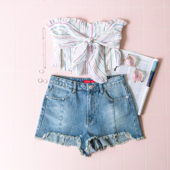 -White -Rainbow Stripes -Metallic -Front-Tie -Ruffles -Smocked Back -Tube Top  Model is Wearing Size Small  Material: 88% Cotton 12% Lurex  T16751 TUBE WHTS