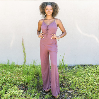 -Berry -Criss Cross Straps in Front -Ties in Front -Bungee Straps -Side Zipper -Pants -Jumpsuit -Lined -Comes in 2 Colors  Model is Wearing Size Small  J8174 JUMP PRP