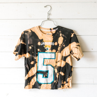 """-Black -Bleached* -Blake Bortles -#5 -Short Sleeve -Cropped -T-Shirt  Size Small  Clothing Measurements: Bust: 17"""" Length: 19.5"""" Sleeve Length: 8""""  *T-Shirt is cropped and tie-dyed in-house and was not washed after bleaching. We recommend washing before wearing."""