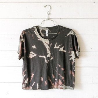 "-Black -Bleached* -Short Sleeve -Cropped -T-Shirt  Size Medium  Clothing Measurements: Bust: 20"" Length: 19"" Sleeve Length: 6.5""  *T-Shirt is cropped and tie-dyed in-house and was not washed after bleaching. We recommend washing before wearing. Bleach patterns may vary."