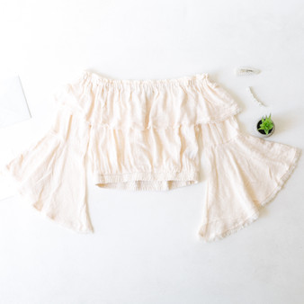 -Cream -Fringe Hem -Off-Shoulder -Elastic Waist -Bell Sleeves -Ruffles -Crop -Top -Unlined -Comes in 4 Colors  Model is Wearing Size Small  Material: 100% Cotton  FL20F701-CROP-CRM