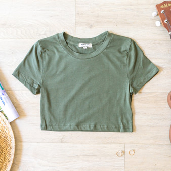 -Olive -Short Sleeve -Crop -Top -Comes in 2 Colors -Runs Small  Model is Wearing Size Small  Material: 55% Cotton 37% Rayon 8% Spandex  JT38723 CROP OLV