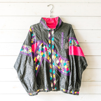 "-Black -Multi Pattern -Zip Up -Pockets -Collar -Lined -Lightweight  Size X-Large  Material: Shell: 100% Nylon Lining: 65% Polyester 35% Cotton  Clothing Measurements: Bust: 24"" Length: 26"" Sleeve Length: 23"""