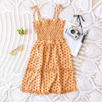 -Amber -Polka Dots -Smocked Bodice -Ruffles -Tie Straps -Unlined -Dress -Comes in 2 Patterns  Model is WearingSize Small  Material: 100% Polyester  JBD1158 DRESS YELD
