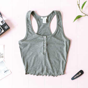 -Army Green -Ribbed -Snap Closure -Lettuce Edge Hem -Eraser Back -Tank -Fabric Stretches -Comes in 4 Colors  Model is Wearing Size Small  Material: 61% Polyester 32% Rayon 7% Spandex  RT62224 TANK GRN