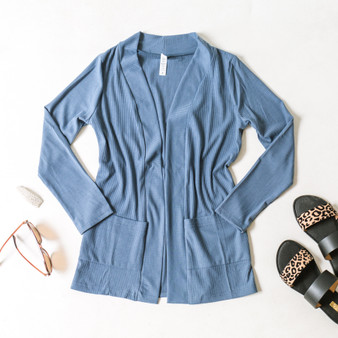 -Blue Gray -Ribbed -Pockets -Long Sleeve -Cardigan -Comes in 2 Colors  Model is Wearing Size Small  Material: 96% Polyester 4% Spandex  T2617R CARDI BLU