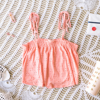 -Peach -Eyelet Pattern -Tie Straps -Smocked -Unlined -Comes in 4 Colors -Tank  Material: 96% Polyester 4% Spandex  JC39314 TANK PNK