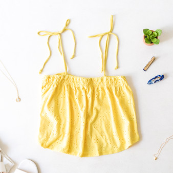 -Yellow -Eyelet Pattern -Tie Straps -Smocked -Unlined -Comes in 4 Colors -Tank  Material: 96% Polyester 4% Spandex  JC39314 TANK YEL