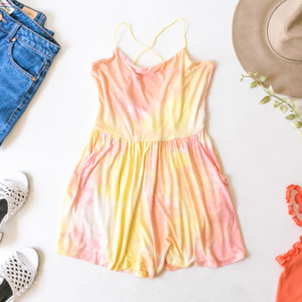 -Yellow -Orange -Tie-Dye -Bungee Straps -Open Back -Pockets -Elastic Waist -Unlined -Fabric Stretches -Comes in 2 Colors -Romper  Material: 95% Rayon 5% Spandex  AR38202T49 ROMP YTD