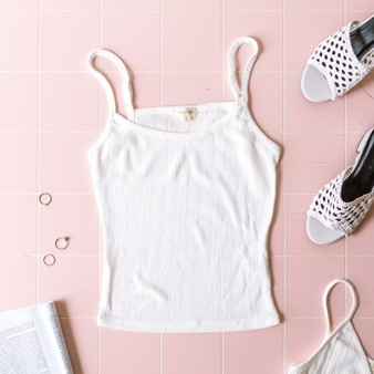 -Ivory -Pointelle -Round Neck -Adjustable Straps -Unlined -Fabric Stretches -Comes in 2 Colors -Camisole  Material: 81% Nylon 19% Spandex  JC39515 CROP WHT