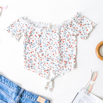 -White -Floral Print -Waffle Fabric -Lettuce Edge Trim -Front Tie -Fabric Stretches -Comes in 3 Colors -Top  Model is Wearing Size Small  Material: 60% Cotton 35% Rayon 5% Spandex  JT39321P CROP WHTF