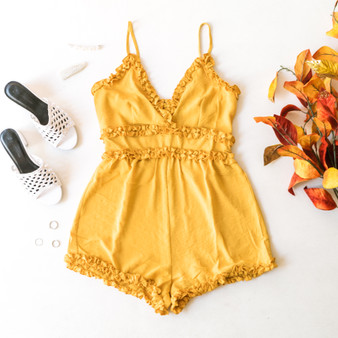 -Mustard -Ruffles -V-Neck -Zipper -Unlined -Fabric Does Not Stretch -Comes in 4 Colors -Romper  Material: 100% Polyester  IP7881 ROMP YEL