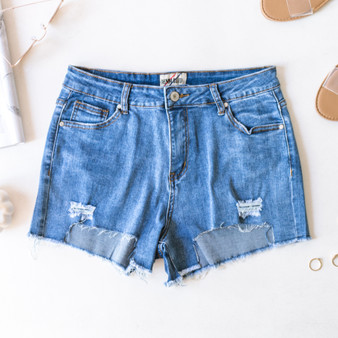 -Medium Wash -Ripped -Frayed -Distressed -Raw Hem -Pockets -Belt Loops -Silver Button -Zipper -Fabric Stretches -Comes in 2 Washes -Shorts  Material: 71% Cotton 25% Polyester 2% Viscose 2% Spandex  OS2530 SHORT MDD
