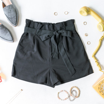 -Black -Bow -Ties -Belt Loops -Pockets -Elastic Waist -High Waist -Paper Bag Style -Fabric Stretches -Comes in 2 Colors -Shorts  Model is Wearing Size Small  Material: 95% Polyester 5% Spandex  94767 SHORT BLK