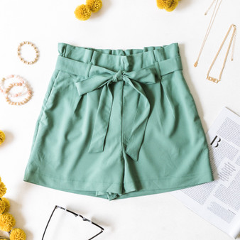 -Jade -Bow -Ties -Belt Loops -Pockets -Elastic Waist -High Waist -Paper Bag Style -Fabric Stretches -Comes in 2 Colors -Shorts  Material: 95% Polyester 5% Spandex  94767 SHORT GRN
