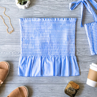 -Light Blue and White -Gingham -Smocked -Ruffle -Unlined -Comes in 3 Colors -Fabric Stretches -Skirt -Set  Model is Wearing Size  Material: 50% Cotton 50% Polyester  SW905 SET SKIRT BLU