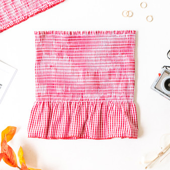 -Red and White -Gingham -Smocked -Ruffle -Unlined -Comes in 3 Colors -Fabric Stretches -Skirt -Set  Model is Wearing Size  Material: 50% Cotton 50% Polyester  SW905 SET SKIRT RED