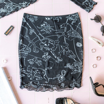 -Black -Constellation Print -Elastic Waist -Fabric Stretches -Mesh -Skirt -Lined  Model is Wearing Size Small  Material: Shell: 92% Polyester/8% Spandex Lining: 95% Polyester/5% Spandex  P2414 SKIRT ZODI