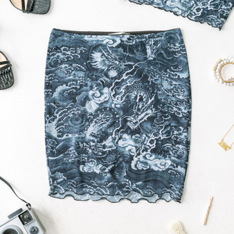 -Navy -Dragon Print -Mesh -Lined -Lettuce Edge -Fabric Stretches -Skirt  Model is Wearing Size Small  Material: 93% Polyester 7% Spandex  P2375 SKIRT DGON