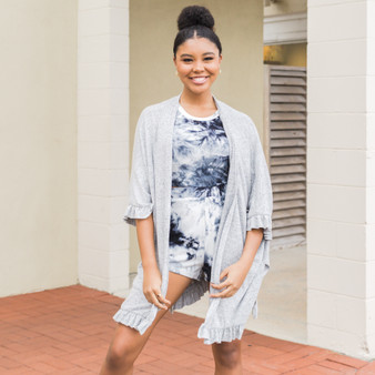 -Heather Gray -Ruffled Sleeves and Hem -Open Front -Half Sleeve -Cardigan -Comes in 4 colors  Model is Wearing Size Small  Material: 80% Polyester 15% Rayon 5% Spandex  RUFFLED CARDI GRY