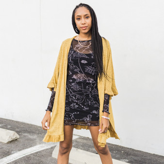 -Mustard -Ruffled Sleeves and Hem -Open Front -Half Sleeve -Cardigan -Comes in 4 colors  Model is Wearing Size Small  Material: 80% Polyester 15% Rayon 5% Spandex  RUFFLED CARDI YEL
