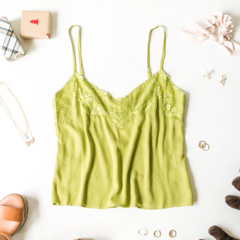 -Chartreuse -Adjustable spaghetti straps -Lace lining -V Neckline -Fabric stretches -Full length -Top -Unlined   Model is wearing size Small  Material: 100% Rayon  40300 TANK GRN