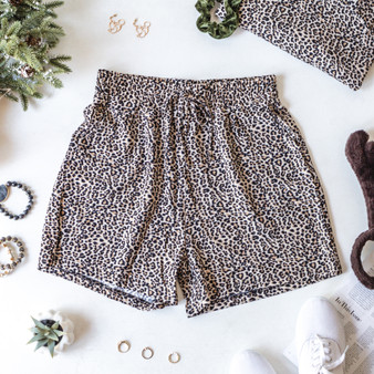 -Tan -Leopard Print -High Waist -Drawstring Shorts -Pockets -Unlined -Comes in 2 Colors -Set  Model is Wearing Size  Material: 95% Polyester 5% Spandex  PS9268 SHORT CHTT