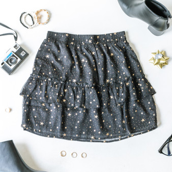 -Black -Gold metallic star print -Ruffled lining -Elastic waistband -Fabric does not stretch -Skirt  Model is Wearing Size Small  Material:  Self: 100% Polyester Lining: 97% Polyester  3% Spandex  MS3268 SKIRT STAR