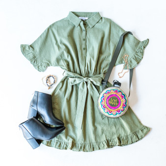 -Green -Lined -Collar -Short Sleeves with ruffle detail -Elastic waist -Detachable belt -Front buttons -Ruffled hem detail -Dress -Comes in 3 Colors  Model is Wearing Size Small  Material: Self: 100% Cotton Lining:  100% Rayon  FL20J130 DRESS GRN