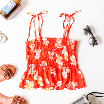 -Red -Floral Print -Tie Straps -Square Neck -Smocked -Ruffle Hem -Fabric Stretches -Unlined -Tank  Model is Wearing Size Small  Material: 100% Polyester  MT8221 TANK ORGF