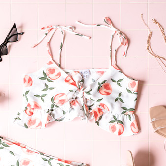 -White -Peach Print -Front Tie -Tie Straps -Spaghetti Straps -Lined -Fabric Does Not Stretch -Shorts -Set  Model is Wearing Size Small  Material: 100% Polyester  TP5085 CROP PCH