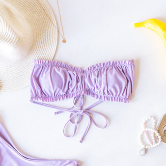 -Lilac -Ties -Ruched Bust -Bandeau -Removable Pads -Lined -Swim -Set -Top  Model is Wearing Size Medium  Material: 80% Nylon | 20% Spandex  SWIM TOP PRP STRAPL