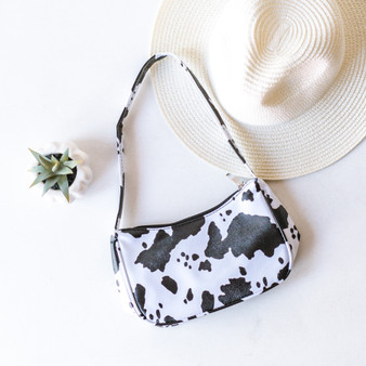 -Black and White -Cow Print -Zipper Closure -Comes in 2 Colors