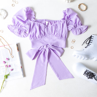 -Lavender -Puff Sleeve -Sweetheart Neck -Back Tie -Ruffle Trim -Fabric Does Not Stretch -Unlined -Comes in 5 Colors -Crop  Model is Wearing Size Meium  Material: 100% Polyester  TGI3472 CROP PRP