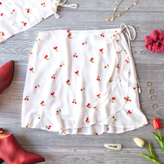 -White -Cherry Print -Wrap -Ties -Ruffles -Lined -Skirt -Set -Runs Large Model is Wearing Size Small  Material: 100% Rayon  CS3048 SKIRT CHRY