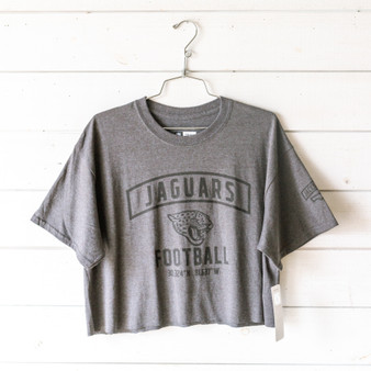 "-Heather Charcoal  -Crew Neck -Jaguars Football Graphic -Short Sleeve -Cropped -T-Shirt  Size Large  Material: Unknown  Clothing Measurements: Bust: 22"" Length: 19"" Sleeve Length: 8"""