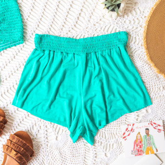 -Aqua -Smocked Waist -High Waist -Fabric Stretches -Unlined -Comes in 6 Colors -Set -Shorts  Model is Wearing Size Small  Material: 100% Rayon  PJ701HRS SHORT MNT