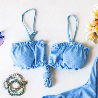 -Baby Blue Color -Ruffle on Top and Bottom -V Cut in the Middle -Spaghetti Strap -Tie Back -Removable Pads -Lined -Swim -Set -Top  Material: 82% Polyester | 18% Spandex  SWIM TOP3 BLU
